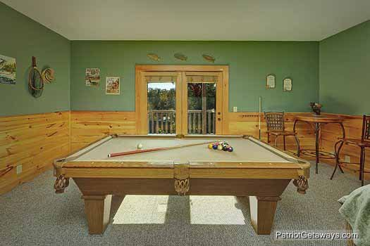 Pool table in the game room at Logged Out, a 3 bedroom cabin rental located in Pigeon Forge