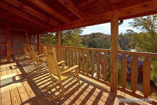 Rocking chairs on covered deck at Logged Out, a 3 bedroom cabin rental located in Pigeon Forge