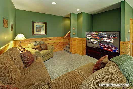 Sectional sofa in the game room at Logged Out, a 3 bedroom cabin rental located in Pigeon Forge