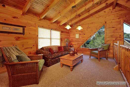 Sofa bed in the loft at Logged Out, a 3 bedroom cabin rental located in Pigeon Forge