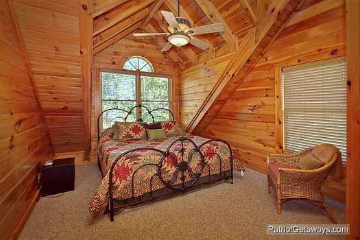 Third floor bedroom with king bed at Logged Out, a 3 bedroom cabin rental located in Pigeon Forge
