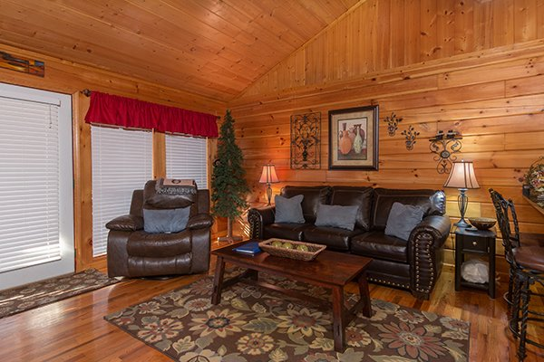 living room with couch and recliner at a beary cozy escape a 1 bedroom cabin rental located in pigeon forge
