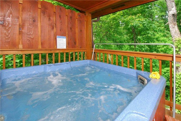 hot tub with privacy fence and woods view at a beary cozy escape a 1 bedroom cabin rental located in pigeon forge