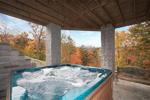 Hot tub on the first floor patio at Big Bear Lodge, a 7-bedroom cabin rental located in Gatlinburg