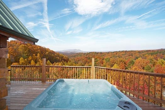 Hot tub on the main floor deck at Big Bear Lodge, a 7-bedroom cabin rental located in Gatlinburg