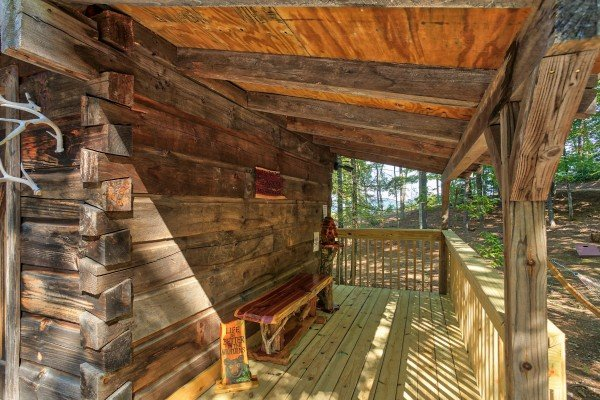 Small covered porch at bearfoot adventure a 2 bedroom cabin rental located in gatlinburg
