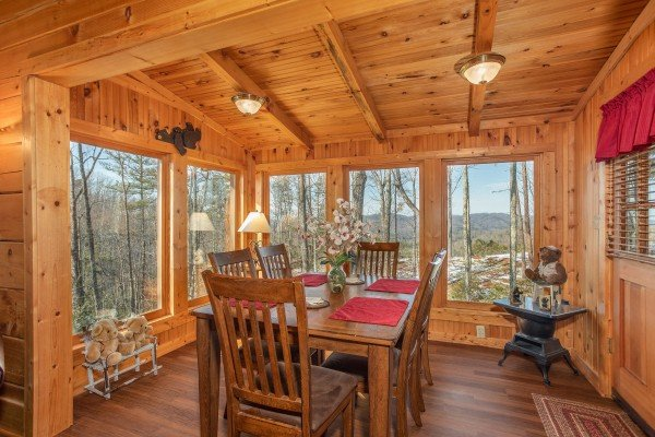 Dining space for 6 at Bearfoot Adventure, a 2 bedroom cabin located in Gatlinburg