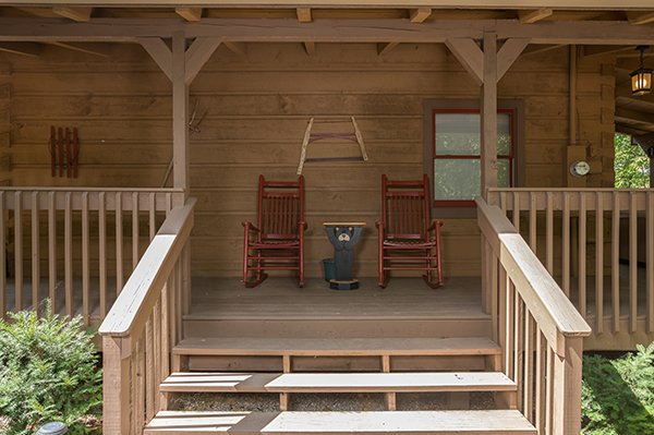 Two rocking chairs at the entry at Bearfoot Adventure, a 2-bedroom cabin rental located in Gatlinburg