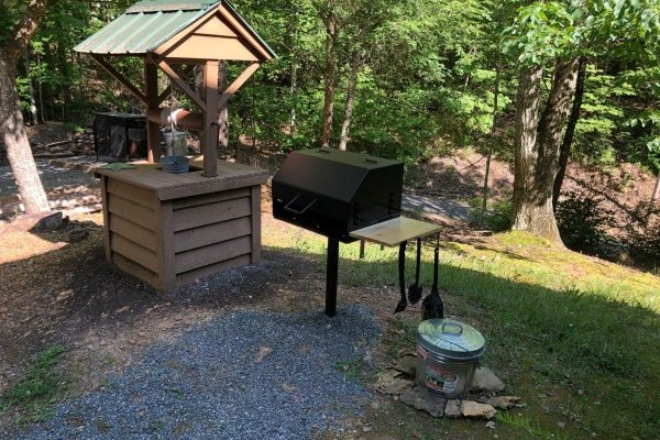 Charcoal grill and landscaping at Bearfoot Adventure, a 2 bedroom cabin rental located in Gatlinburg