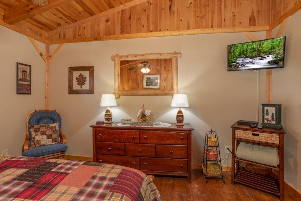 Dresser, console table, and TV in the loft bedroom at Bearfoot Adventure, a Gatlinburg Cabin rental