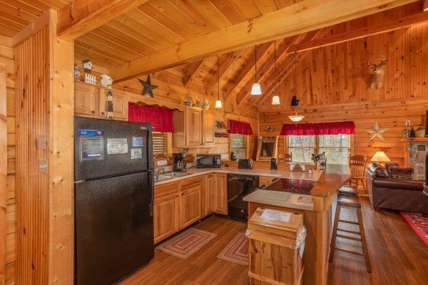 Kitchen with black appliances at Bearfoot Adventure, a 2 bedroom cabin located in Gatlinburg