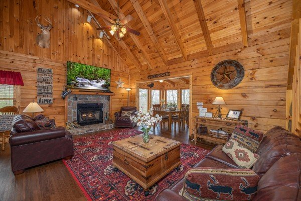 Living room with fireplace and seating at Bearfoot Adventure, a Gatlinburg Cabin rental