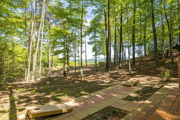 Patio with cornhole at Bearfoot Adventure, a 2 bedroom cabin rental located in Gatlinburg