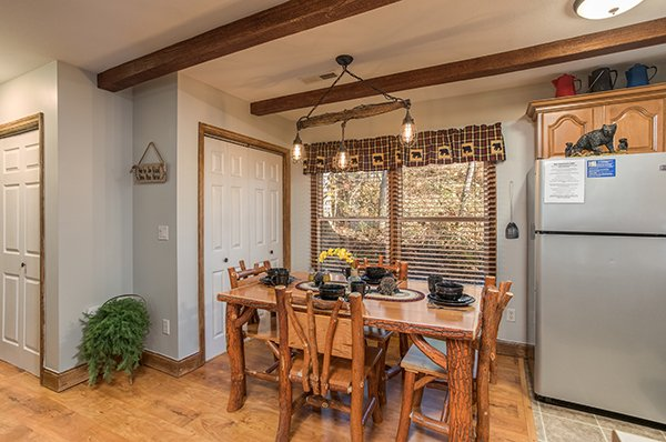 Log dining set for four people off the kitchen at Kabbe Bear Cabin, a 1 bedroom cabin rental located in Gatlinburg