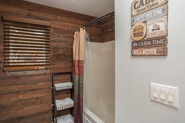 Bathroom with a tub and shower at Kabbe Bear Cabin, a 1 bedroom cabin rental located in Gatlinburg