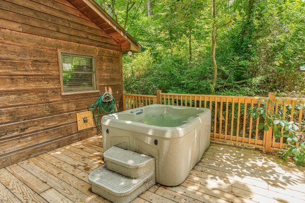 Hot tub on the deck at Kabbe Bear Cabin, a 1 bedroom cabin rental located in Gatlinburg