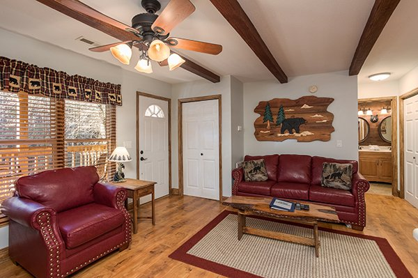 Couch and chair in the living room at Kabbe Bear Cabin, a 1 bedroom cabin rental located in Gatlinburg