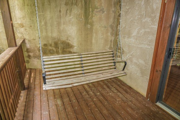 swing on the deck at angel's place a 2 bedroom cabin rental located in pigeon forge