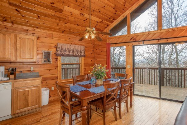 Dining table with seating for six at Angel's Place, a 2 bedroom cabin rental in Pigeon Forge