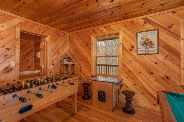Foosball and arcade game in the game room at Angel's Place, a 2 bedroom cabin rental in Pigeon Forge