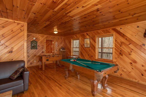 Pool and foosball in the game room at Angel's Place, a 2 bedroom cabin rental in Pigeon Forge