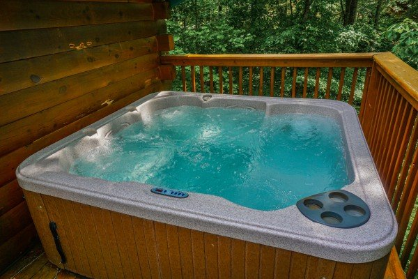 hot tub on the deck outside at angel's place a 2 bedroom cabin rental located in pigeon forge