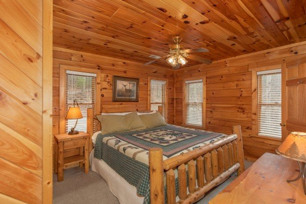 King log bed in a bedroom at Angel's Place, a 2 bedroom cabin rental in Pigeon Forge