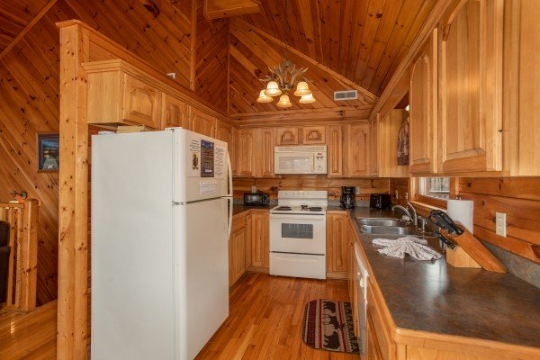 Kitchen with white appliances at Angel's Place, a 2 bedroom cabin rental in Pigeon Forge