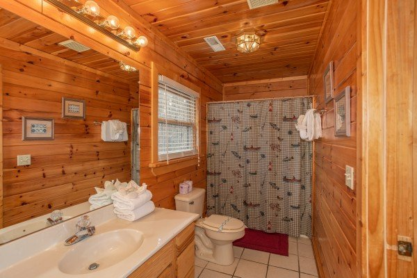 Bathroom with a tub and shower at Angel's Place, a 2 bedroom cabin rental in Pigeon Forge