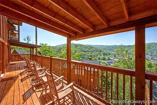 Rocking chairs on the deck at Elk Horn Lodge, a 5-bedroom cabin rental located in Gatlinburg
