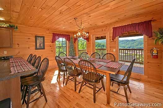 Dining table for eight at Elk Horn Lodge, a 5-bedroom cabin rental located in Gatlinburg