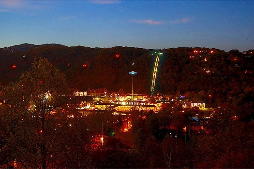 Gatlinburg lit up at night seen from Elk Horn Lodge, a 5-bedroom cabin rental located in Gatlinburg