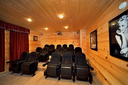 Fifteen individual seats in the home theater at Elk Horn Lodge, a 5-bedroom cabin rental located in Gatlinburg