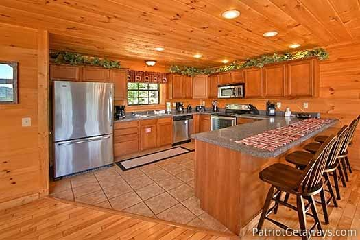 Commercial grade stainless refrigerator at Elk Horn Lodge, a 5-bedroom cabin rental located in Gatlinburg