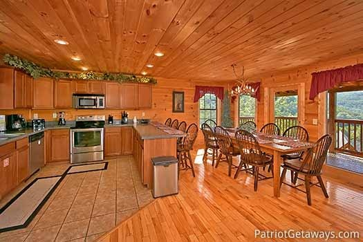 kitchen with connected dining room at elk horn lodge a 5 bedroom cabin rental located in gatlinburg