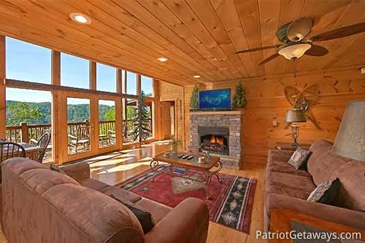 living room with stone fireplace at elk horn lodge a 5 bedroom cabin rental located in gatlinburg