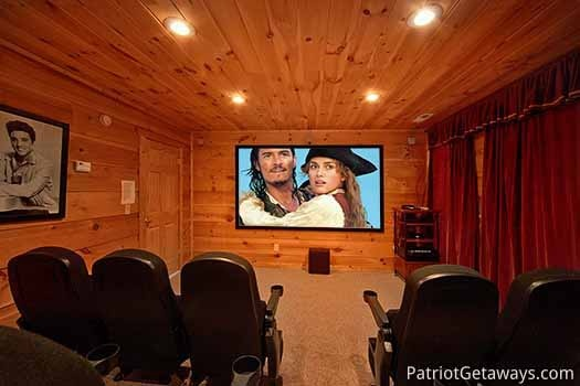 home theater screen is one hundred and twenty inches long at elk horn lodge a 5 bedroom cabin rental located in gatlinburg