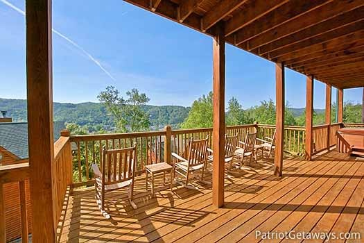 Rocking chairs on the deck of Elk Horn Lodge, a 5-bedroom cabin rental located in Gatlinburg