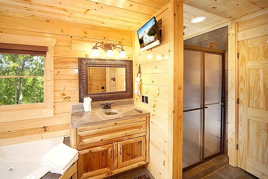 shower in attached bathroom on main level at incredible! a 6 bedroom cabin rental located in gatlinburg