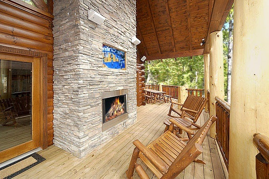 fireplace on the deck with tv above at incredible! a 6 bedroom cabin rental located in gatlinburg