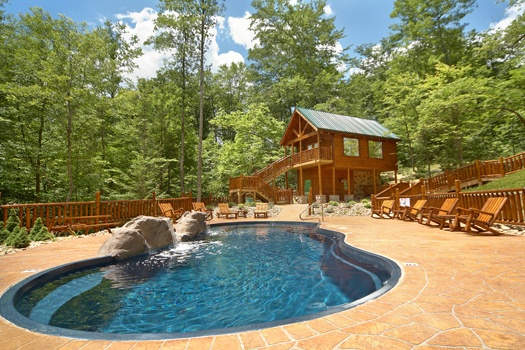 swim at the resort pool when staying at incredible! a 6 bedroom cabin rental located in gatlinburg