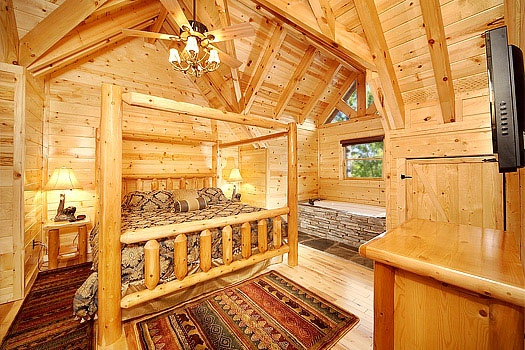 third floor bedroom with in room jaccuzzi tubat incredible! a 6 bedroom cabin rental located in gatlinburg