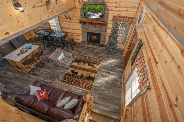 Looking down at the living room from the upper floor at Allstar Pool Lodge, a 4 bedroom cabin rental located in Pigeon Forge