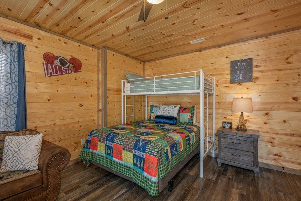 Queen bed under a twin bed at Allstar Pool Lodge, a 4 bedroom cabin rental located in Pigeon Forge