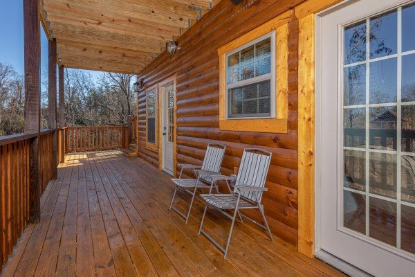 Chairs on a deck at Allstar Pool Lodge, a 4 bedroom cabin rental located in Pigeon Forge