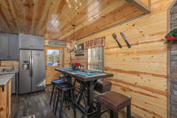 Dining table for six at Allstar Pool Lodge, a 4 bedroom cabin rental located in Pigeon Forge