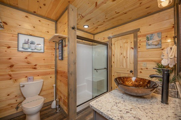 Bathroom with shower and copper sink at Allstar Pool Lodge, a 4 bedroom cabin rental located in Pigeon Forge
