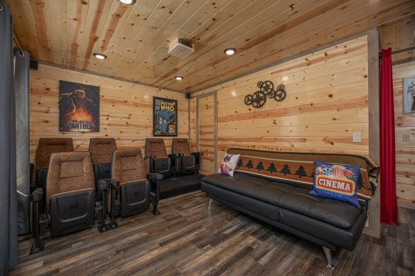 Theater seats and a sofa at Allstar Pool Lodge, a 4 bedroom cabin rental located in Pigeon Forge
