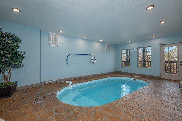 Indoor pool at Allstar Pool Lodge, a 4 bedroom cabin rental located in Pigeon Forge