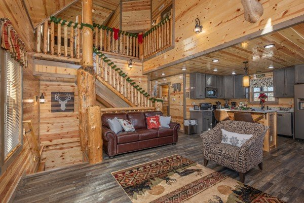 Living room and kitchen at Allstar Pool Lodge, a 4 bedroom cabin rental located in Pigeon Forge